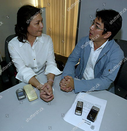 Abs Cbn Television Network Executive Vice President Charo Santos Concio Talks to Wowowee Tv Host Willie Revillame (r) During a Fact Finding Investigation Held Inside the Office of the Interior Local Government Department (dilg) in Quezon City North of Manila Sunday 05 February 2006 Philippines President Gloria Macapagal Arroyo Summoned Television Executives and Security Officials to Submit a Fact Finding Report 72 Hours After the Stampede Incident at the Stadium Which Left at Least 74 People Dead and Nearly 400 Injured On Saturday Most of the Victims Were Erderly Women Who Fell Down a Slope Beside the Stadium Or Trampled to Death in a Crowd Composed of 50 000 During the Stampede Officials and Politicians Commented That the Tragedy Was an Illustration of the Plight of Poor Filipinos Who Were Desperate to Win a Small Fortune Or Even a Minor Prize During the First Anniversary Celebration of a Local Popular Game Show at the Stadium
