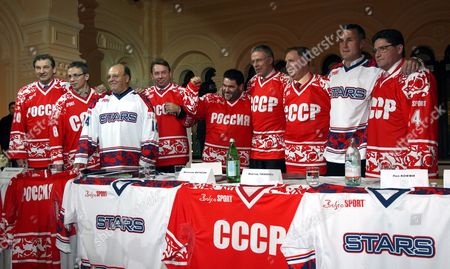 Former World Famous Ice Hockey Russian and Nhl Stars: (l-r) Goalkeeper Vladislav Tretyak Russian Nhl Player Igor Larionov Russian President's Official Vladimir Kozhin Sports Fashion Businessman Mikhail Kusnirovich Legendary Player Viacheslav Fetisov Russian Head Coach Viktor Tikhonov Nhl Player Paul Coffey and Russian Player Sergey Makarov Pose For the Media in Hockey Uniform in Moscow Wednesday 06 December 2006 Old Stars of Russian and World Ice Hockey Will Play a Full-format Match On the Red Square Skating Rink On 09 December