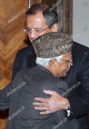 Russian Foreign Minister Sergei Lavrov (background) Hugs His Indian Counterpart Natwar Singh During Their Meeting in Moscow Friday 28 October 2005