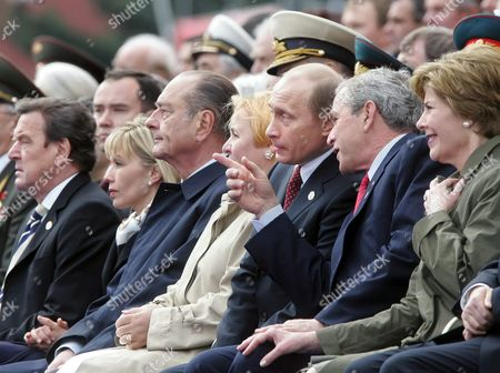 Us President George W Bush (2nd R) Speaks with Russian President Vladimir Putin (3rd R) While Us First Lady Laura Bush (r) German Chancellor Gerhard Schroeder (l) and His Wife Doris Schroeder-koepf (2nd L) French President Jaques Chirac (3rd L) and Russian First Lady Lyudmila Putina (c) Review the Military Parade On Red Square in Moscow As Part of Commemorations Marking the 60th Anniversary of the End of World War Ii in Europe Monday 09 May 2005 Russia Pays a Last Major Salute to the Heroes of World War Ii Monday As 2 500 Veterans Ride in Vintage Trucks Across Red Square Beneath the Respectful Gaze of More Than 50 World Leaders