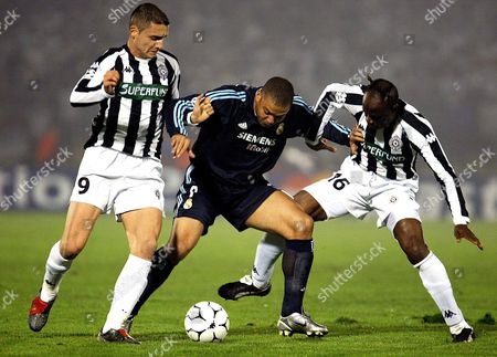 Ronaldo (c) of Real Madrid Fights For the Ball with Andrija Delibasic (l) and Taribo West (r) of Partizan During Their Uefa Champions League First Round 2nd Leg Match in Belgrade Tuesday 04 November 2003 Real Won the First Match 1:0