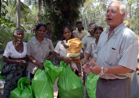 Metall Official Wolfgang Becker (r) Delivers Goods to People in Ahungalle Sri Lanka Friday 28 January 2005