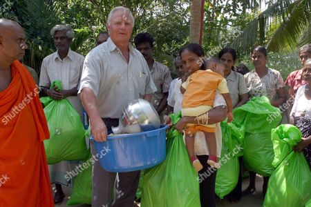 Metall Official Wolfgang Becker (c) Delivers Goods to People in Ahungalle Sri Lanka Friday 28 January 2005