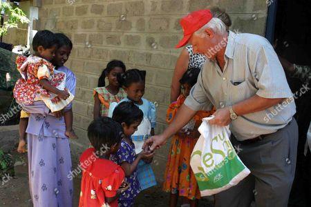Metall Official Wolfgang Becker (r) Distributes Presents to Children in Durga Sri Lanka Friday 28 January 2005 Epa/m a Pushpa Kumara