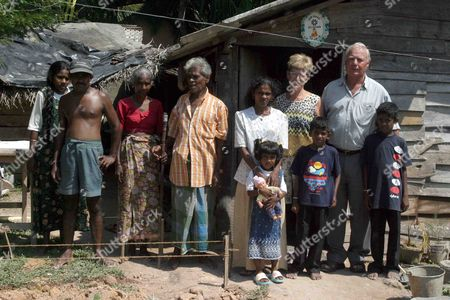 Metall Official Wolfgang Becker (2ndr) Stands with Local People in Ahungalle Sri Lanka Friday 28 January 2005