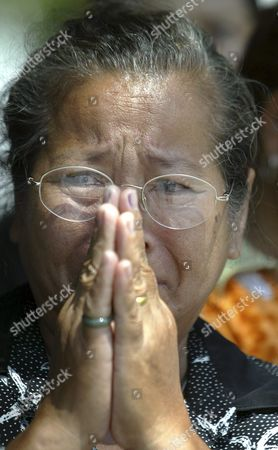 A Thai Woman Greets and Weeps During the Cremation Ceremony of Thai King Bhumipol Adulyadej 'S Grandson Khun Bhumi Jensen Near the Royal Grand Palace in Bangkok Thailand Saturday 30 April 2005 Khun Bhumi Jensen the Only Son of Princess Ubolratana Rajakanya the Eldest Daughter of Their Majesties the King and Queen Died When the Tsunami Struck the Andaman Coast in Southern Thailand On 26 December