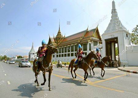 Thai Royal Guards Ride Horses During the Cremation Ceremony of Thai King Bhumipol Adulyadej 'S Grandson Khun Bhumi Jensen Passing by the Royal Grand Palace in Bangkok Thailand Saturday 30 April 2005 Khun Bhumi Jensen the Only Son of Princess Ubolratana Rajakanya the Eldest Daughter of Their Majesties the King and Queen Died When the Tsunami Struck the Andaman Coast in Southern Thailand On 26 December