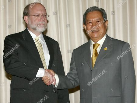 New Thai Interim Prime Minister General Surayud Chulanont (r) Greets to United States Ambassador to Thailand Ralph L Boyce (l) During a Meeting at the Government House Bangkok Thailand Monday 02 October 2006 the Us Demands Thailand Interim Prime Minister Suraud Who Was Sworn in As the Military Coup Chosen and Thai King Approved Keeping a Promise to Step Back and Plan to Restore Democracy