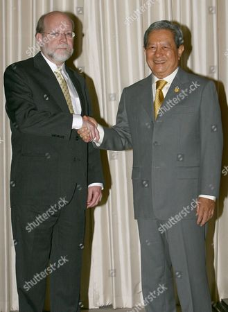New Thai Interim Prime Minister General Surayud Chulanont (r) Greets to United States Ambassador to Thailand Ralph L Boyce (l) During a Meeting at the Government House Bangkok Thailand Monday 02 October 2006 Surayud Who Was Sworn in As the Military Coup Chosen and Thai King Approved New Interim Prime Minister Start His Work On Monday Said That He Would Need One Week to Name His Cabinet and That He Would Focus On the Nation's Happiness Rather Than Its Gdp