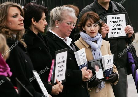 Carie Lemack (2nd R) and Other Relatives of 9/11 Victims Protest the Slow Pace Congress Has Taken On the Intelligence Reform Bill in Front of the White House in Washington Dc Monday 6 December 2004 Carie Lemack Holds a Picture of Her Mother Judy Who Was Killed On American Airlines Flight 11