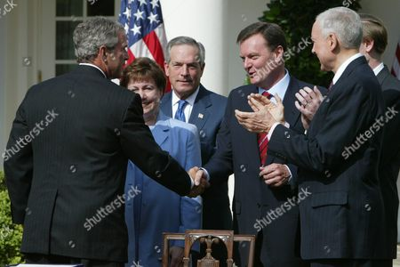 U S President George W Bush Shakes Hands with Australian Ambassador to the U S Michael Thawley After Signing H R 4759 the U S -australia Free Trade Agreement Implementation Act in the Rose Garden of the White House August 3 2004 From L-r: Bush Secretary of Agriculture Ann Veneman Secretary of Commerce Don Evans Thawley and Senator Orin Hatch (r-ut)