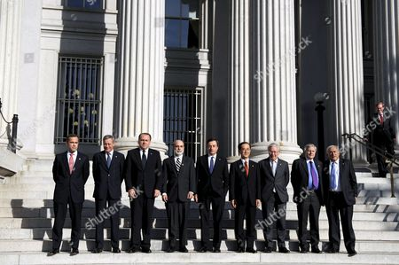 G7 Bank Governors (l-r) Bank of Canada Governor Mark Carney Bank of France Governor Christian Noyer President of Germany's Bundesbank Axel a Weber Chairman of the Us Federal Reserve Ben Bernanke Italy's Central Bank Governor Mario Draghi Japan's Central Bank Governor Masaaki Shirakawa Bank of England Governor Mervyn King President of the European Central Bank Jean Claude Trichet and International Monetary Fund (imf) Managing Director Dominique Strauss-kahn Pose For a Group Photo During the G7 Ministers Meetings at the Us Treasury in Washington D C Usa 10 October 2008 Us President George W Bush Said the Us Government Will 'Aggressively' Use a 'Wide Range of Tools' to Help Stabilize Markets and Resolve the Financial Crisis