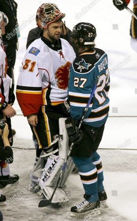 San Jose Sharks Jeremy Roenick (l) and Calgary Flames Goalie Curtis Joseph (r) Talk Following the Sharks Win in Game Seven at Hp Pavilian in San Jose California 22 April 2008 Roenick Scored Two Goals As the Sharks Beat the Flames 5-3