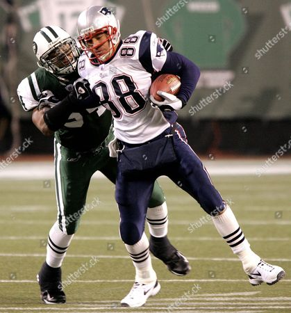 New England Patroit's Christian Fauria is Tackled by New York Jet's Victor Hobson After Catching a Pass in the Second Quarter Against the New York Jets at Giant Stadium in East Rutherford New Jersey Sunday 26 December 2004