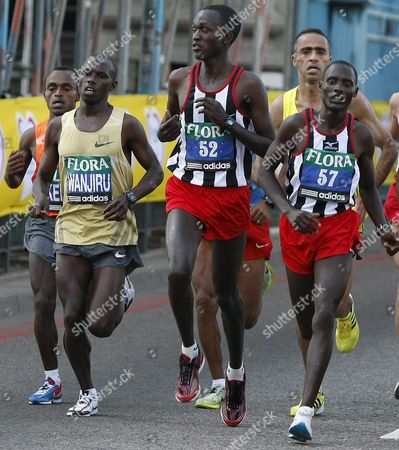 Leading the Race Elite Marathon Runners with Favorite Kenyan Sammy Wanjiru (l) Among Them Cross Tower Bridge During the Flora London Marathon Britain 26 April 2009 Top Elite Athletes Run Together with Charity Fund Raisers and Sport Enthusiasts Along the Capital½s Most Famous Landmarks the London Marathon is the the Biggest Running Event in the Uk with Over 40 000 Runners Participating