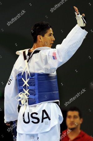 Mark Lopez of the Usa Waves to Supporters Following His Victory Over Daniel Manz of Germany in the Men's -68kg Taekwon-do Quarterfinal Match at the Beijing University of Science and Technology During the Beijing 2008 Olympic Games in Beijing China 21 August 2008 Mark Lopez Won the Match and Went On to Win the Silver Medal