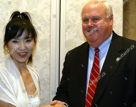 Stock Image of Award Winning Jazz Artist Keiko Matsui(l)shakes Hands with James T Morris Executive Director of the U N World Food Programme During the the International Conference On African Development (ticad) Iii in Tokyo Tuesday 30 September 2003 Cited As Top Contemporary Jazz Artist of the Year by Billboard Magazine in 1996 Matsui is Dedicating Her Upcoming Concert Tours and a Song On Her New Album to Wfp Efforts Epa Photo/epa/everett Kennedy Brown// Japan Tokyo