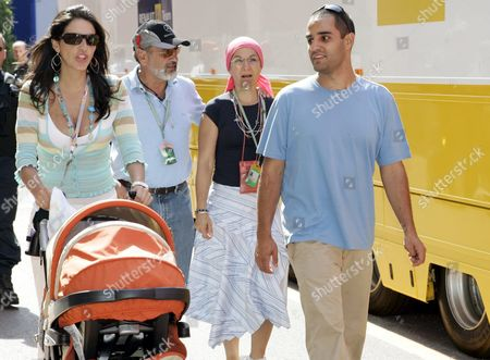 Mclaren Mercedes' Colombian Driver Juan Pablo Montoya (r) His Colombian Wife Connie Montoya (l) with Their New-born Son Sebastian (in the Buggy) His Father Pablo (2-l) and Mother (no Name Available) with Their New-born Son Sebastian at the Monaco Grand Prix Paddock in Monte Carlo Monaco Friday 20 May 2005 the Grand Prix of Monaco Takes Place On Sunday 22 May 2005