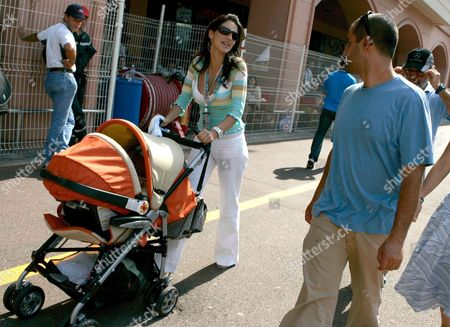 Mclaren Mercedes' Colombian Driver Juan Pablo Montoya (r) and His Colombian Wife Connie Montoya (l) with Their New-born Son Sebastian (in the Buggy) at the Monaco Grand Prix Paddock in Monte Carlo Monaco Friday 20 May 2005 the Grand Prix of Monaco Takes Place On Sunday 22 May 2005