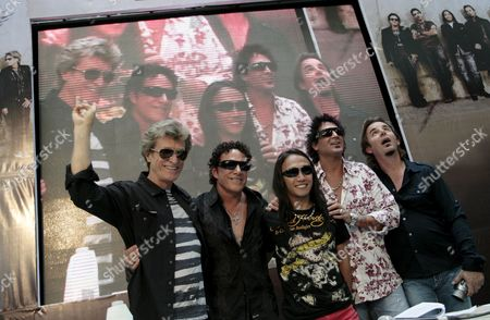 Filipino Singer Arnel Pineda (c) Joins Us 'Journey' Rock Band Mainstays Ross Valory (l) Neal Schon (2nd-l) Deen Castronovo (2nd-r) Jonathan Cain (r) During a Press Conference in Quezon City East of Manila Philippines 02 March 2009 Pineda is the Band's New Lead Vocalist Journey is in Manila For a One Night Concert
