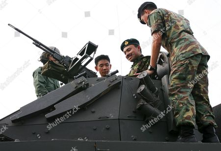 Prince Haji Al-muhtadee Billah (r) the Crown Prince of Brunei Darussalam Rides a Bionix Infantry Armoured Vehicle in the Singapore Commando Headquarters On Thursday 10 March 2005 the Prince is in the City State For an Official Five-day Visit to Reaffirm Close Bilateral Ties Between Brunei and Singapore