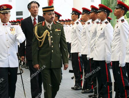 Prince Haji Al-muhtadee Billah (c) the Crown Prince of Brunei Darussalam Inspecting the Guard of Honour with Singapore Minister of Defence Teo Chee Hean (behind) at the Singapore Ministry of Defence On Wednesday 09 March 2005 the Prince is in the City State For an Official Five-day Visit to Reaffirm Good Bilateral Ties Between Brunei and Singapore
