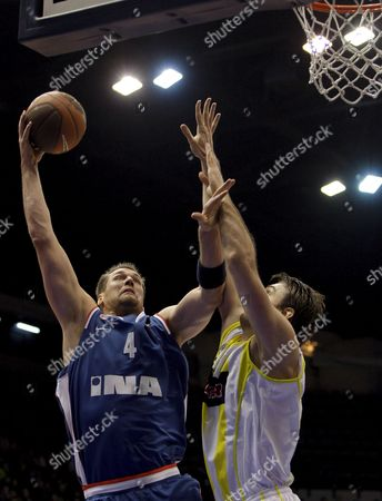 Fenerbahce's Semih Erden (r) Challenge For Ball with Cibona Zagreb's Jared Homan (l) During Their Euroleague Second Round Match at Abdi Ipekci Arena in Istanbul Turkey 25 February 2009