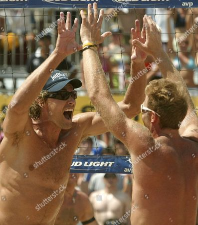 Matt Fuerbringer (l) and Teammate Casey Jennings (r) Celebrate After Winning the Avp Hermosa Beach Open at the Hermosa Beach Pier in Hermosa Beach California Saturday 23 July 2005 Jennings and Fuerbringer Defeated Dax Holdren and Jeff Nygaard 2-1