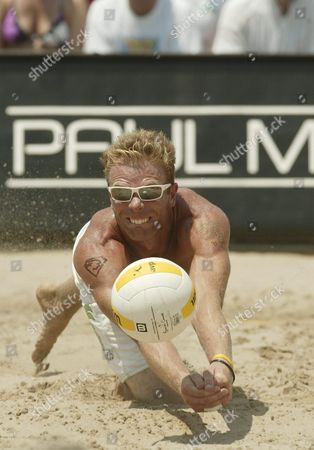 Casey Jennings Dives For a Ball During His Championship Match at the Avp Hermosa Beach Open at the Hermosa Beach Pier in Hermosa Beach California Saturday 23 July 2005 Jennings and Matt Fuerbringer Defeated Dax Holdren and Jeff Nygaard 2-1