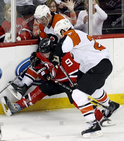 Philadelphia Flyers Center Jeff Carter (top) and Rightwinger Mike Knuble (r) Check New Jersey Devils Zach Parise (c) During the Third Period of the Game Between the Philadelphia Flyers and the New Jersey Devils at the Prudential Center in Newark New Jersey Usa On 28 March 2008