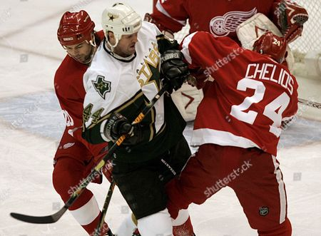 Detroit Red Wings Robert Lang (l) and Chris Chelios (r) Collide On Dallas Stars Jason Arnott During the First Period of Their Nhl Game at Joe Louis Arena in Detroit Michigan Monday 17 April 2006