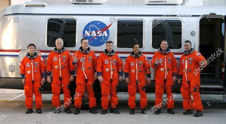 Space Shuttle Discovery Crew On Mission Sts-119 Pose For a Group Photo After Leaving the Operations & Checkout Building (o&c) During Terminal Countdown an Demonstration Tests (tcdt) at Kennedy Space Center (ksc) Cape Canaveral Florida Usa 21 January 2009 Crew Members Are (r-l) Commander Lee Archambault Pilot Tony Antonelli Mission Specialists Joseph Acaba Steve Swanson Richard Arnold John Phillips and Japan Space Agency Koichi Wakata the Seven Man Crew Will Fly On Shuttle Discovery Mission Sts-119 On a Fourteen Day Mission to the International Space Station (iss) the Shuttle Discovery and Crew Will Deliver the Last of the Power P-6 Truss System Along with a Replacement Part For the Water Supply System Japanese Astronaut Koichi Wakata Will Remain at the Iss For the Next Four Months Discovery is Scheduled to Launch No Earlier Than 12 February 2009 at 7:30 a M Edt