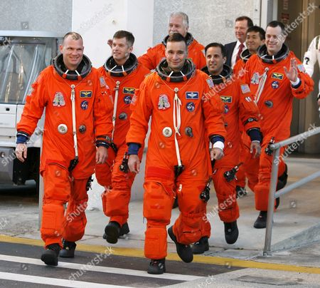 Space Shuttle Discovery Crew On Mission Sts-119 Leaving the Operations & Checkout Building (o&c) During Terminal Countdown an Demonstration Tests (tcdt) at Kennedy Space Center (ksc) Cape Canaveral Florida Usa 21 January 2009 Crew Members Are (r-l) Commander Lee Archambault Pilot Tony Antonelli Mission Specialists Joseph Acaba Steve Swanson Richard Arnold John Phillips and Japan Space Agency Koichi Wakata the Seven Man Crew Will Fly On Shuttle Discovery Mission Sts-119 On a Fourteen Day Mission to the International Space Station (iss) the Shuttle Discovery and Crew Will Deliver the Last of the Power P-6 Truss System Along with a Replacement Part For the Water Supply System Japanese Astronaut Koichi Wakata Will Remain at the Iss For the Next Four Months Discovery is Scheduled to Launch No Earlier Than 12 February 2009 at 7:30 a M Edt