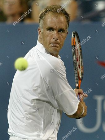Todd Martin of the Us Eyes the Ball Against Fabrice Santoro of France During Their First Round Match at the Us Open in Flushing Meadows New York Monday 30 August 2004