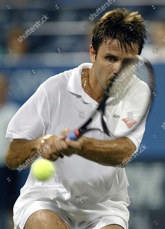 Fabrice Santoro of France Returns the Ball to Todd Martin of the Us During Their First Round Match at the Us Open in Flushing Meadows New York Monday 30 August 2004