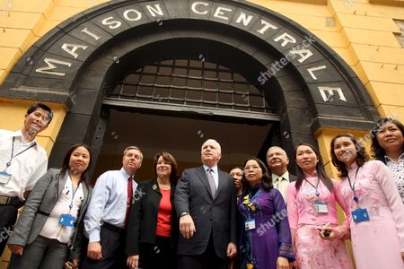 Us Senator John Mccain (c) Poses For Photographs with Senators Amy Klobuchar (4th L) and Lindsey Graham (3rd L) American Ambassador to Vietnam Michael Michalak (4th R) and Vietnamese Officials Outside the Hoa Lo Prison Museum in Hanoi Vietnam 08 April 2009 Mccain a Former Pow Who Spent Five Years in Hoa Lo - Dubbed the 'Hanoi Hilton' - During the Vietnam War Called For Increased Diplomatic Ties Between the Two Countries While Visiting the Vietnamese Capital