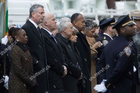 Bill de Blasio, Chirlane McCray, James P. O'Neill, William Bratton New York City Mayor Bill de Blasio, second from left, his wife Chirlane McCray, left, NYPD Commissioner James P. O'Neill third from left, and former Police Commissioner William Bratton, fourth from left, stand at attention during the funeral service for New York City police officer Steven McDonald, at St. Patrick's Cathedral in New York. McDonald died on Tuesday, 30 years after a robbery suspect shot him in Central Park. The officer publicly forgave his assailant and went on to become an international voice for peace