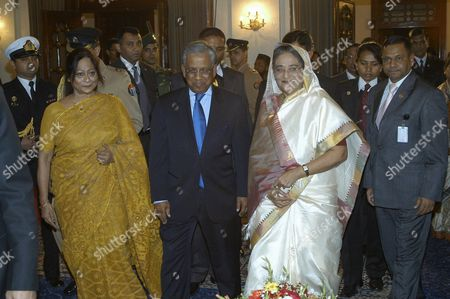 Bangladesh's New Prime Minister Sheikh Hasina (r) Arrives in the Swearing in Ceremony Along with the Chief Adviser of the Non-party Interim Caretaker Government of Bangladesh Fakruddin Ahmed (l) to Take the Oath As the As the 12th Premier of the Country in the Parliament in Dhaka Bangladesh 06 January 2009 Bangladeshs President Iajuddin Ahmed Appointed Awami League (al) Leader Sheikh Hasina Wazed As Prime Minister of the Country On a Five Year Tenure Officials Said Hasina Won a Crushing Victory On 29 December 2008 General Elections Leaders of Several Political Parties Former Ministers Judges Diplomats Civil and Military Bureaucrats and the Countrys Elites Attended the Swearing-in Ceremony