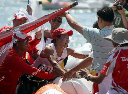 Yin Jian of China Celebrates Her Gold Medal with the Chinese Sailing Team Giving China Its First Ever Olympic Sailing Gold in the Womens Rs:x Women's Windsurfing Event in Qingdao China 20 August 2008 Italys Alessandra Sensini Won the Silver Medal and Bryony Shaw of Great Britain Won Bronze
