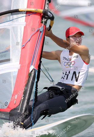 Yin Jian of China in Action to Gain China It's First Ever Olympic Sailing Gold in the Womens Rs:x Women's Windsurfing Event in Qingdao China 20 August 2008 Italys Alessandra Sensini Won the Silver Medal and Bryony Shaw of Great Britain Won Bronze