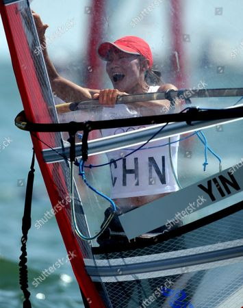 Yin Jian of China Celebrates Her Gold Medal Win Giving China Its First Ever Olympic Sailing Gold in the Womens Rs:x Women's Windsurfing Event in Qingdao China 20 August 2008 Italys Alessandra Sensini Won the Silver Medal and Bryony Shaw of Great Britain Won Bronze