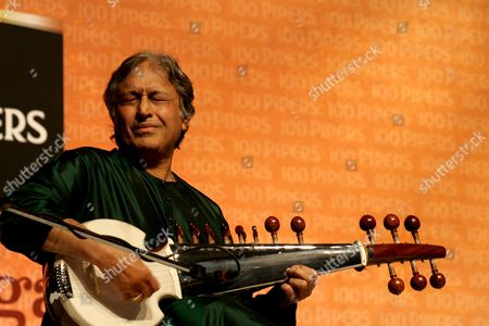 Indian Musician Ustad Amjad Ali Khan Performs On the Sarod During the Sarod Concerto 'Samaagam' with Scottish Chamber Orchestra Members (unseen) in Eastern Indian City of Calcutta On 11 February 2009 Welsh Conductor David Murphy Leads the Orchestra the Concert is Part of a Six-city India Tour