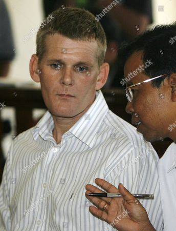 British Ronnie Ramsay (c) Listens to His Interpreter During His Trial at a Denpasar District Court in Bali Indonesia On 13 September 2007 Indonesian Judges Sentenced Ronnie Ramsay to Ten Month in Prison Ramsay Was Arrested in Bali After Being Caught with Small Amount of Heroin On February 2007