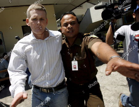 British Ronnie Ramsay (c) Escorted by Court Officer After His Trial at a Denpasar District Court in Bali Indonesia On 13 September 2007 Indonesian Judges Sentenced Ronnie Ramsay to Ten Month in Prison Ramsay Was Arrested in Bali After Being Caught with Small Amount of Heroin On February 2007