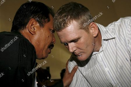 British Ronnie Ramsay (c) Listens to His Lawyer Indonesian Erwin Siregar (l) During His Trial at a Denpasar District Court in Bali Indonesia On 13 September 2007 Indonesian Judges Sentenced Ronnie Ramsay to Ten Month in Prison Ramsay Was Arrested in Bali After Being Caught with Small Amount of Heroin On February 2007