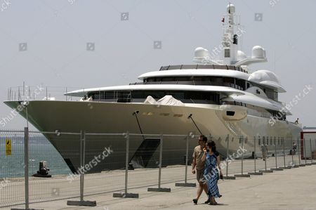 People Walk in Front of a Yacht Owned by Russian Billionaire Roman Abramovic the 'Belorus' in the Harbour of Lisbon Portugal Thursday 10 June 2004 Abramovic is in Portugal to Watch Some Matches of the European Soccer Championship Euro2004