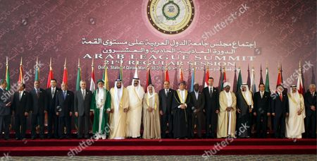 Stock Image of (l-r) Arab League Secretary General Amr Moussa Yemen President Ali Salah Mauritanian President General Mohamed Ould Abd Aziz Morocco Prince Moulay Rachid Egyptian Minister For Legal and Parliamentary Affairs Mufid Shehab Lebanese President Michel Sulieman Comores Islands President Ahmed Abdallah Sambi Uae President Sheikh Khalifa Bin Zayed Al-nahayan (l-r) Qatari Emir Sheikh Hamad Bin Khalifa Al-thani Kuwaiti Emir Sheikh Sabah Al-ahmad Al-sabah and Iraqi Prime Minister Nuri Al-maliki Oman Prime Minister Somali President Sheikh Sharif Ahmed Syrian President Bashar El Assad Sudan President Omar Hassan El Bashir Saudi Arabian King Abdullah Tunisian President Tunisian President Zine El Abidine Ben Ali Jordanian King Abdullah Bahrain King Hamad Bin Isa Al-khalifa and Palestinian President Mahmoud Abbas Pose For a Group Photo Before the Opening Session of the Arab Summit in Doha Qatar 30 March 2009 the Appearance of Sudan's President Omar Hassan Al-bashir Flouting an International Arrest Warrant is Set to Overshadow Efforts to Heal a Deep Arab Rift Over How to Handle Rising Power Iran
