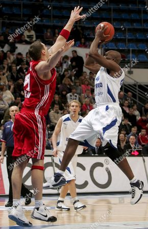 Henry Domercant (r) of Dynamo (moscow) Attacks As Jared Homan (l) of Asko Slask (wroclaw) Tries to Stop Him During Their Basketball Uleb Cup Match in Moscow Russia 26 February 2008