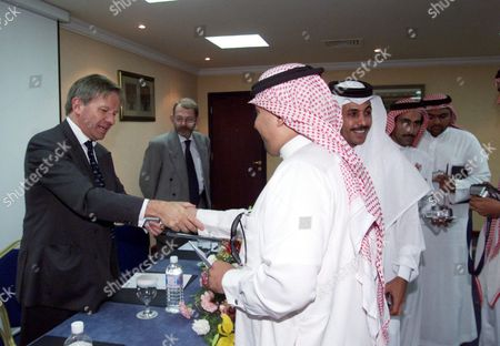 British Ambassador to Saudi Arabia Sherard Cowper-coles (l) Talks to Membes of the Local Saudi Media After His Press Conference in a Hotel in Yanbu On Sunday 02 May 2004 After Four Men Entered a Construction Compound and Opened Fire Randomly at Local and Foreign Workers 01 May Local Police Shot and Killed Three of the Men Trying to Escape in Stolen Vehicles According to an Official of the Saudi Interior Ministry Two Britons Three Americans an Australian and a Member of the Saudi National Guard Were Reportedly Killed by the Attackers