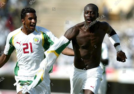 Senegal's Striker Khalilou Fadiga (r) Celebrates Scoring a Goal with Team Mate Habib Beye (l) During Thier African Group 1 Soccer World Cup Qualifying Match Against Liberia in Dakar Senegal Saturday 26 March 2005 the Bolton Wanderers Club Player Khalilou Fadiga Scored Along with Fellow Teamate Two-time African Player of the Year El Hadji Diouf to Take Senegal to Lead in Group 1 with 13 Points